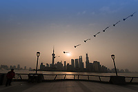 Shanghai, China - April 7, 2013:one man kiting on the bund at the city of Shanghai in China on april 7th, 2013