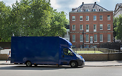 © Licensed to London News Pictures. 12/07/2016. London, UK. A blue removal van is parked outside the back of Downing Street as David Cameron's last cabinet takes place.  Theresa May will become Prime Minister tomorrow after the last candidate for leadership of the Conservative party stood down. Photo credit: Peter Macdiarmid/LNP