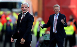 Stoke City manager Mark Hughes and Sunderland manager David Moyes both look frustrated during the Premier League fixture between their sides - Mandatory by-line: Robbie Stephenson/JMP - 15/10/2016 - FOOTBALL - Bet365 Stadium - Stoke-on-Trent, England - Stoke City v Sunderland - Premier League