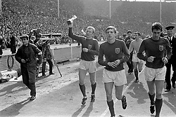 England captain Bobby Moore (l) parades the World Cup around Wembley after his team's 4-2 win, alongside goalscorers Martin Peters (second l) and Geoff Hurst (r), and goalkeeper Gordon Banks (second r)