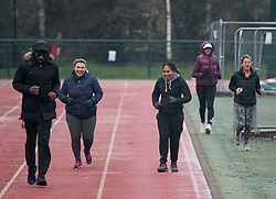 © Licensed to London News Pictures. 07/01/2021. London, UK. Members of the public exercise in freezing, early morning conditions at Paddington Recreation Ground in West London, during a third national Lockdown. Photo credit: London News Pictures.