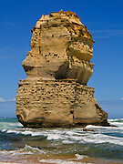 """One of the two sea stacks of """"Gog and MaGog"""" rises from the Indian Ocean (or Southern Ocean according to Australian geographers) offshore of Port Campbell National Park, Victoria, Australia. Twelve Apostles Marine National Park protects a collection of miocene limestone rock stacks offshore of the Great Ocean Road. The Great Ocean Road (B100) is a 243-km road along the southeast coast of Australia between Torquay and Warrnambool, in the state of Victoria. Dedicated to casualties of World War I, the Great Ocean Road was built by returned soldiers between 1919 and 1932 and is the world's largest war memorial."""
