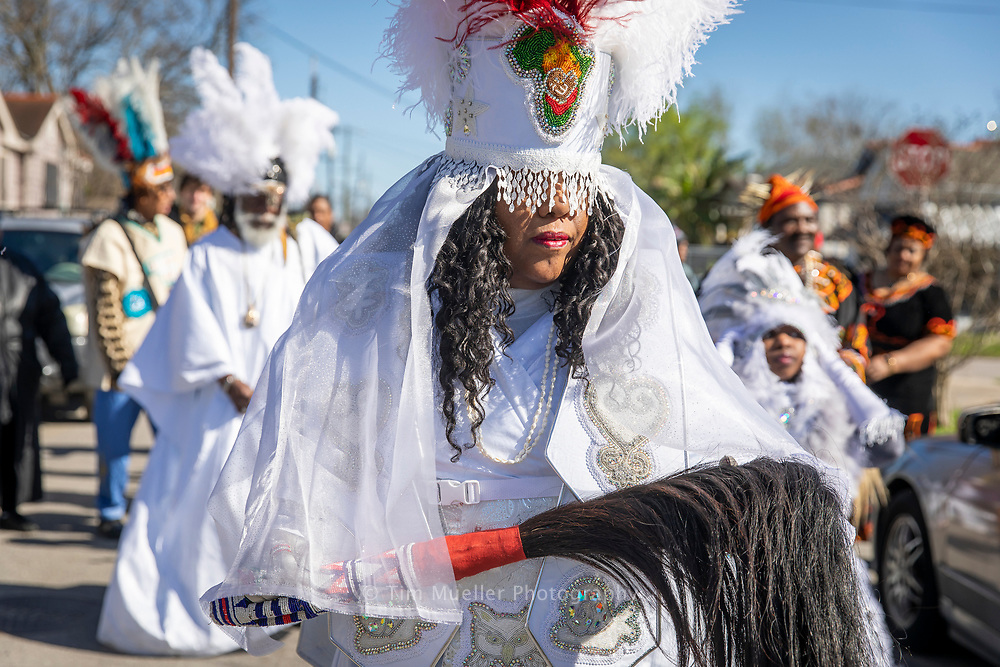 Cherice Harrison-Nelson, Big Queen of the Guardians of the Flame Mardi Gras Indians leads the Young Guardians of the Flame and the Congo Kids as they parade on Mardi Gras day in the New Orleans Bunny Friend neighborhood.