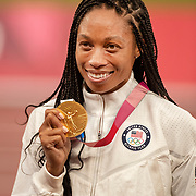 TOKYO, JAPAN August 7:  Allyson Felix of the United States with her gold medal after the United States team won the 4x 400m relay final. Allyson Felix is now the most decorated U.S. track athlete in Olympic history. She won her 11th medal just one day after becoming the most-decorated woman in Olympic track history when she won bronze in the 400m during the Track and Field competition at the Olympic Stadium  at the Tokyo 2020 Summer Olympic Games on August 7th, 2021 in Tokyo, Japan. (Photo by Tim Clayton/Corbis via Getty Images)