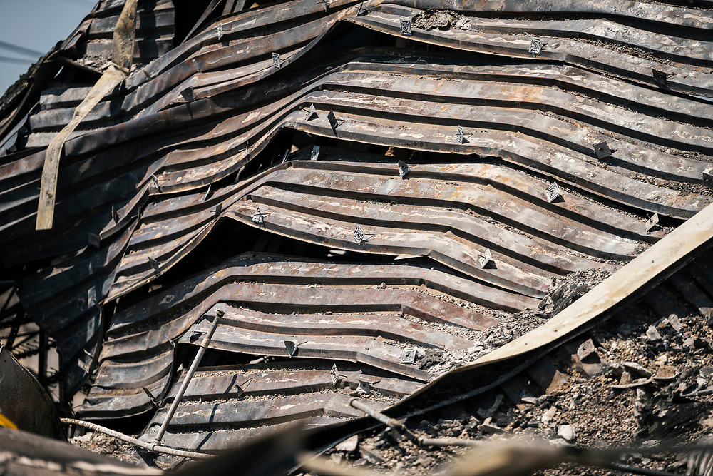 The charred and destroyed roof of the Autozone building along Lake Street in Minneapolis, Minnesota on Monday, June 1, 2020. The auto parts store was damaged extensively during the civil unrest in the final days of May following the death of George Floyd at the hands of Minneapolis Police Department officers.