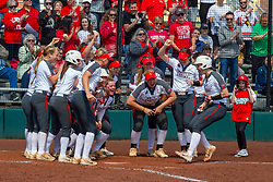 NORMAL, IL - April 06: The dugout clears and lines up at home plate to congratulate Brittni LaFountaine on her homerun hit during a college women's softball game between the ISU Redbirds and the University of Northern Iowa Panthers on April 06 2019 at Marian Kneer Field in Normal, IL. (Photo by Alan Look)