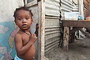 A young girl stands in the doorway of her home in the West Point slum in Monrovia, Montserrado county, Liberia on Monday April 2, 2012.