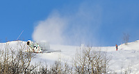 Snow Making Machine. Image taken on the train from Oslo to Bergen Norway winter of 2007. Image taken with a Nikon D2xs and 80-400 mm VR lens (ISO 100, 400 mm, f/6.3. 1/160 sec)