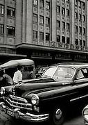 C012-29_Tom Hutchins_Large modern car opposite shopping Centre, Wang Fu Chin, Peking, China 1956 A2.tif