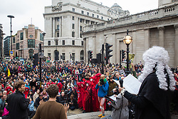 London, UK. 14 October, 2019. Climate activists from Extinction Rebellion stage theatrical mock trials, of the UK's financial sector for the crime of ecocide and of the Government for 'criminal negligence' in having permitted it, in front of the Bank of England. Roads were blocked around Bank on the eighth day of International Rebellion protests across London.