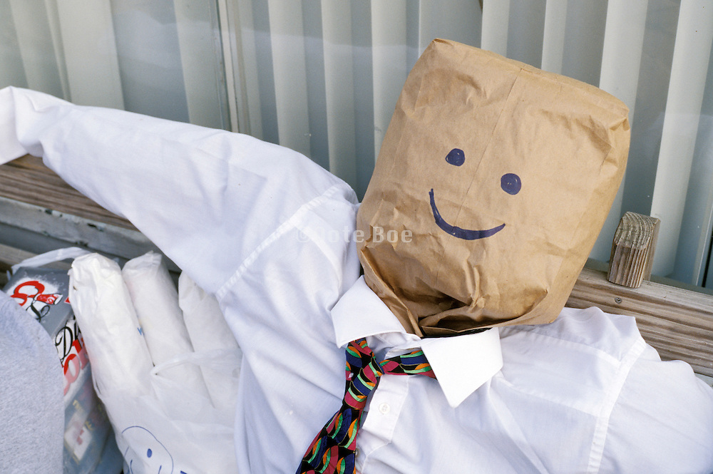 stuffed figure with paper bag head