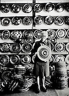 """""""Betty Hubcap"""" at her Liberty City salvage yard in Miami,1983."""