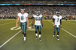 DETROIT - SEPTEMBER 19: Punter Sav Rocca #6, linebacker Ernie Sims #50 and quarterback Michael Vick #7 of the Philadelphia Eagles walk out for the coin toss during the game against the Detroit Lions on September 19, 2010 at Ford Field in Detroit, Michigan. (Photo by Drew Hallowell/Getty Images)  *** Local Caption *** Sav Rocca;Ernie Sims;Michael Vick