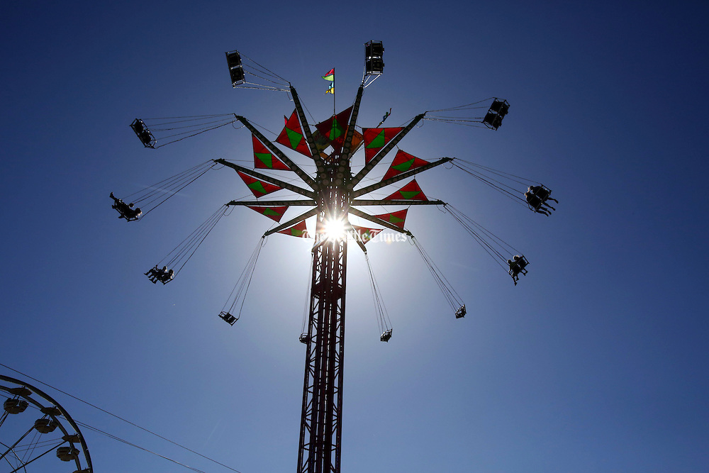 Riders take to the sky on Vertigo, one of the  midway attractions at the Spring Fair in Puyallup, Washington.<br /> <br /> Alan Berner / The Seattle Times