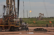 OIl field workers at a fracksite in  Eddy County New Mexico. Eddy County's oil patch in the Permian Basin is experiencing an oil boom due to the fracking industry.