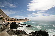 The sky, the Pacific Ocean, the rocks, and Capella Pedregal beach.