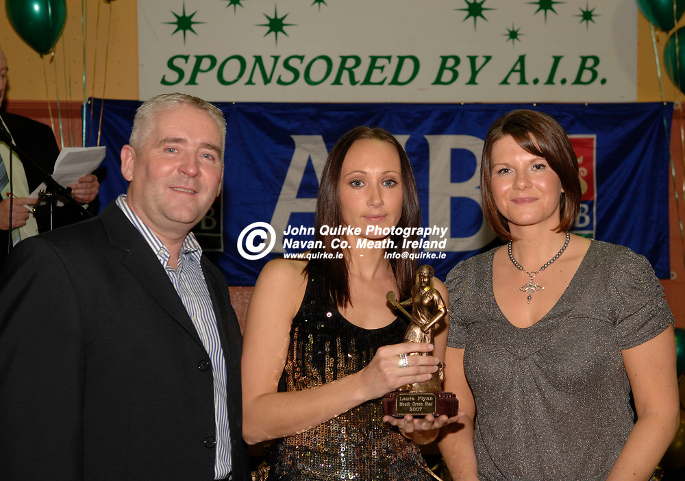 30-11-07. Meath Green Stars Banquet at Simonstown.<br /> Cormac Farrell, O'Neills and Debbie Breen, AIB presenting a Meath Camogie Green Star Award to Laura Flynn, Navan O'Mahony's.<br /> Photo: John Quirke / www.quirke.ie<br /> ©John Quirke Photography, Unit 17, Blackcastle Shopping Cte.<br /> Navan. Co. Meath. 046-9079044 / 087-2579454.