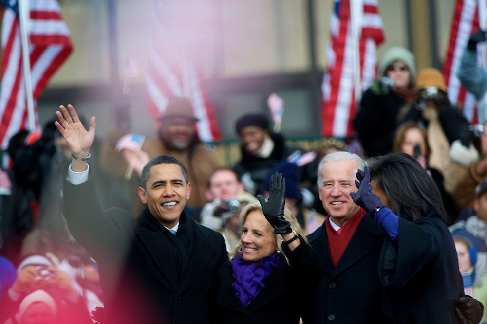During their pre-inauguration rally in Wilmington, Delaware, President-elect Obama, Jill Biden, Vice President- elect Biden, and Michele Obama wave to the crowd of thousands, who braved sub-zero temperatures to lend their support.  Obama and Biden along with their families traveled by train on a Whistle Stop Tour, opening Inauguration celebrations with rallies in Philadelphia, Wilmington, and Baltimore before their final arrival in Washington, D.C.  The inauguration takes place on January 20, 2009, swearing Obama in as the 44th President of the United States of America.¬?
