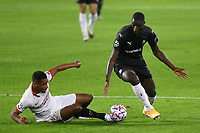 SEVILLE, SPAIN - OCTOBER 28: Fernando Reges of FC Sevilla and Sehrou Guirassy of Stade Rennais during the UEFA Champions League Group E stage match between FC Sevilla and Stade Rennais at Estadio Ramon Sanchez-Pizjuan on October 28, 2020 in Seville, Spain. (Photo by Juan Jose Ubeda/ MB Media).