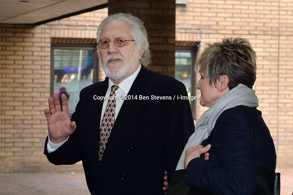 Dave Lee Travis speaks to press outside of Southwark Crown Court after being found not guilty of all but two charges. Pictured with his wife Marianne Griffin.<br />  Thursday, 13th February 2014. Picture by Ben Stevens / i-Images