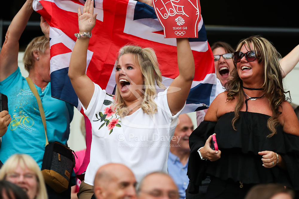 London, 2017-August-04. A woman cheers during the crowd warm-up ahead of the IAAF World Championships London 2017. Paul Davey.