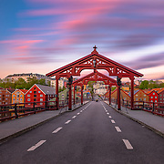 Gamle bybro (Lykkens portal). Old town bridge in a fantastic midnight sunset in Trondheim. Enjoy and share it :)