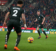 Kevin De Bruyne of Manchester City ® passes the ball to Kyle Walker of Manchester City. Premier league match, Stoke City v Manchester City at the Bet365 Stadium in Stoke on Trent, Staffs on Monday 12th March 2018.<br /> pic by Andrew Orchard, Andrew Orchard sports photography.