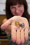 Graz, Austria. Jeweler Hermine Prügger with bear rings at her boutique store.
