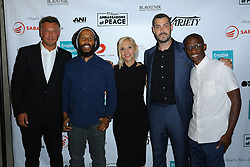 Walter Kolm, left, Ziggy Marley, Jacqueline Saturn, Aaron Bay-Shuck and Troy Carter at Creative Community For Peace 2nd Annual 'Ambassadors Of Peace' Gala held at Los Angeles on September 26, 2019 in Private Residence, California, United States (Photo by © Jc Olivera/VipEventPhotography.com