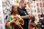 Statue of Jesus Christ at one of the stalls at the 2nd International Tattoo Convention in London on Saturday, Oct. 7, 2006, in London, UK. With over 15.000 visitors in three days during the 2005 edition, the event placed London in a central position in the tattoo world.  This year about 150 artists ,representing all the tattoo styles, are ticking away with their machines in a very exciting atmosphere. **ITALY OUT**....