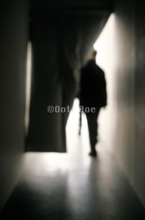 People walking into the light