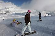 Italy, Madonna di Campiglio, young snowboarder