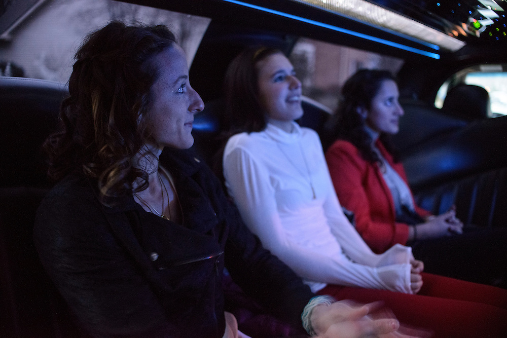 Photo by Matt Roth.Assignment ID: 10136387A..Paralympic gold medalist Tatyana McFadden, 23, left, sits with her two younger adopted sisters Ruthi, 13, middle, and Hannah McFadden, 16, right, inside a limo provided by Tatyana's Paralympic sponsor, BP, who paid forTatyana and her family to have a limo driven night in Baltimore Friday, December 21, 2012...Deborah McFadden stands for a portrait with her daughter Tatyana McFadden, 23, at their home in Clarksville, Marland on Friday, December 21, 2012. Tatyana was adopted from Russia at age 6 with spina bifida. The Paralympic gold medalist, and a group of adopted children, plan to appeal to Russian ambassador.