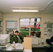 Engineering ground staff of the Red Arrows, Britain's RAF aerobatic team, consult technical information on Mod computers.