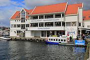 Waterside buildings and boats Vagen harbour, by Torget fish market, Bergen, Norway