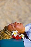 Woman receiving a massage on the beach, Vatulele Island Resort, Fiji Islands