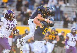 Nov 14, 2020; Morgantown, West Virginia, USA; West Virginia Mountaineers quarterback Jarret Doege (2) celebrates with offensive lineman Zach Frazier (54) after throwing a touchdown pass during the fourth quarter against the TCU Horned Frogs at Mountaineer Field at Milan Puskar Stadium. Mandatory Credit: Ben Queen-USA TODAY Sports