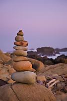 Rock cairn on rugged rocky coastline, Salt Point state park, California