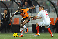FOOTBALL - FRENCH CHAMPIONSHIP 2010/2011 - L1 - FC LORIENT v LILLE OSC - 24/04/2011 - PHOTO PASCAL ALLEE / DPPI - SIGAMARY DIARRA (FCL) / MATHIEU DEBUCHY (LILLE)