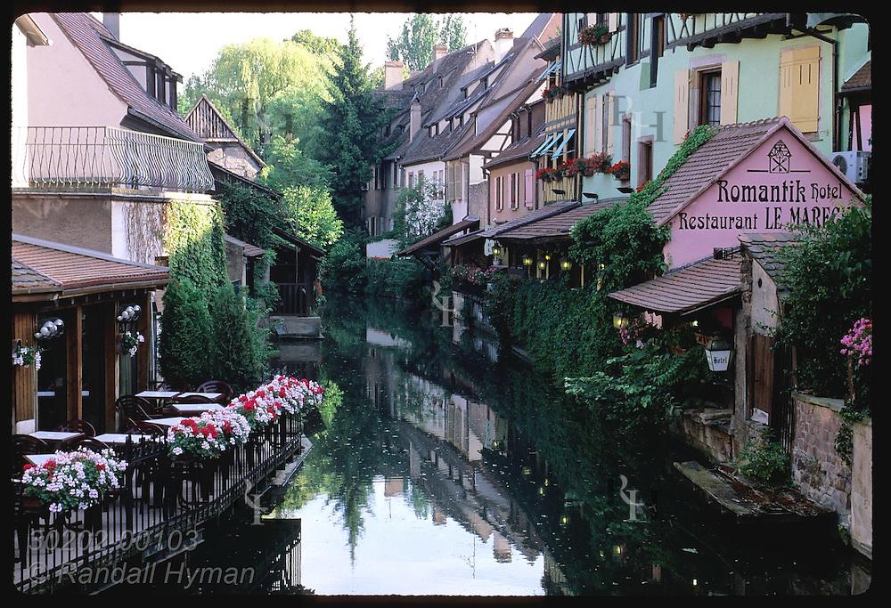 Quaint buildings line the La Lauch canal in the Little Venice district; Colmar, Alsace. France