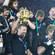 Brad Thorn, New Zealand, with the trophy as his team mates celebrate after New Zealand's 8-7 victory over France in the Final of the IRB Rugby World Cup tournament, Eden Park, Auckland, New Zealand. 23rd October 2011. Photo Tim Clayton...