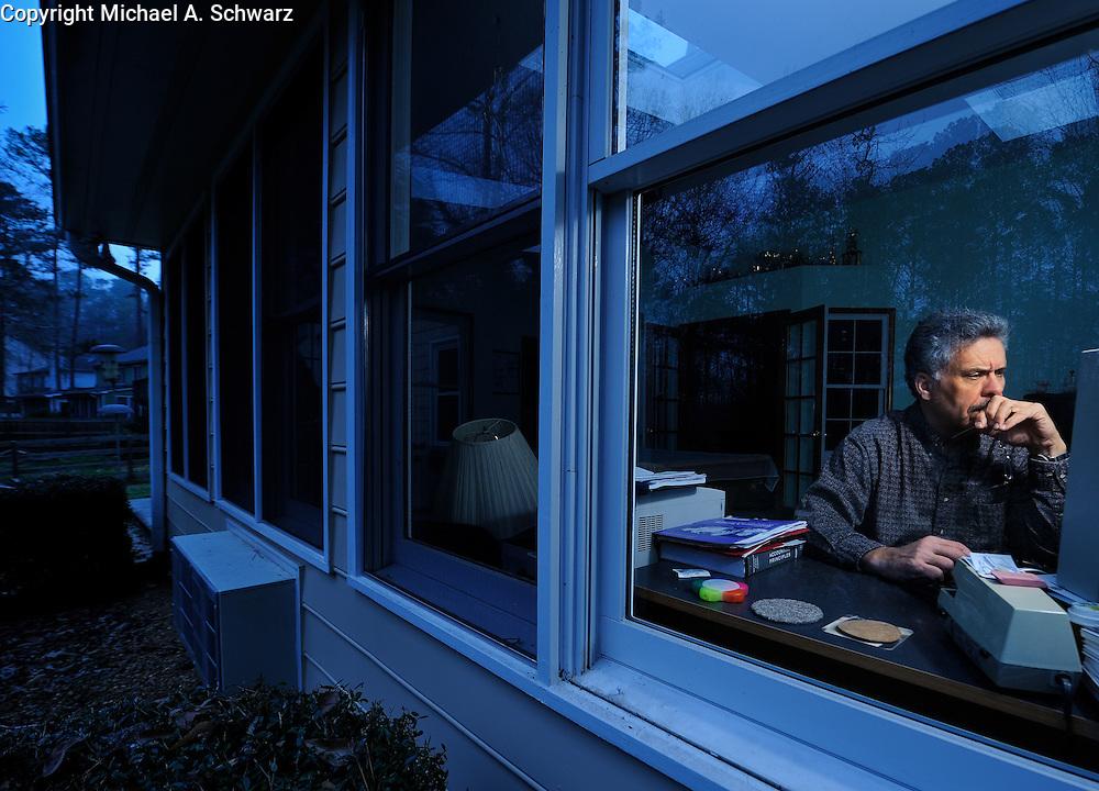 1/27/09  Woodstock, GA<br /> <br /> John McGee looks for work in his home office in Woodstock, GA.