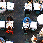 Diners at restaurant tables in the Campo di Fiore in Rome, Italy