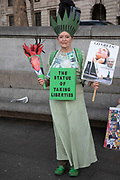 Woman dressed as the Statue of Liberty at the No to Trump, No to NATO, Hands off our NHS Demonstration on 3rd December 2019 in London, United Kingdom. Donald Trump is visiting London or the NATO Heads of State summit on the 70th anniversary of the organisation, which the Queen will be hosting a reception for NATO leaders at Buckingham Palace. Meanwhile, there is fear that Boris Johnson and Donald Trump will be in discussion about opening up the NHS to US corporations. Organisers were Together Against Trump which is a collaboration between the Stop Trump Coalition and Stand Up To Trump.