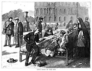 Franco-Prussian War 1870-1871: Once More into the Sun, 1870. Wounded German officers  in the Germany military hospital at Versailles being given fresh air and sunshine to aid their recovery. The man reading to them is Daniel Douglas Home (pronounced Hume) the Scottish Spritualist medium.  From 'The Graphic'. (London, 26 November 1870). Wood engraving.