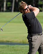 """MASHPEE -- 092110 --  New England Patriots offensive tackle Matt Light takes his swing during the """"Boston Stars for One Family"""" charity event at Willowbend Country Club.<br /> <br /> 092110ch14   Cape Cod Times/Christine Hochkeppel"""