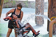 Kids and adults play at Morgan's Inspiration Island, the world's first ultra-accessable splash park for those with and without special needs, that has opened in San Antonio, Texas. The tropical island themed  park cost $17 million and features six major area's for children and adults to play. Every Inspiration Island  area is wheelchair-accessable and features  revolutionary wheelchairs that are powered by compressed air for those who have battery powered chairs that aren't waterproof. Waterproof writsbands featuring RFID technology help parents can easily ascertain where their children are at anytime.