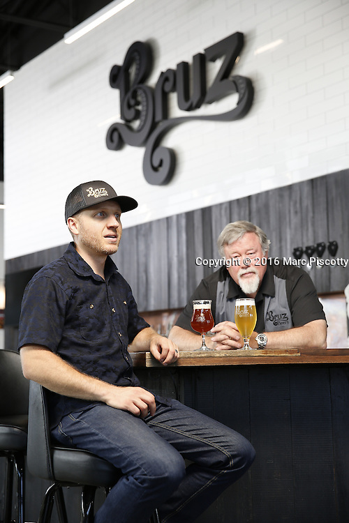 SHOT 7/22/16 1:42:02 PM - Bruz Beers co-founders Charlie Gottenkieny and Ryan Evans inside the new brewery near 67th Avenue and Pecos in Denver, Co. Bruz Beers is Denver's artisanal Belgian-style brewery, featuring a full line of traditional and Belgian-inspired brews, hand-crafted in small batches. Includes images of Evan's dog 'Cooper' as well who serves as the brewery dog. (Photo by Marc Piscotty / © 2016)