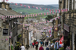© Licensed to London News Pictures. 13/05/2016. Haworth, UK. The streets of  Haworth in West Yorkshire are draped with colourful bunting for the annual 1940s weekend in the town. Photo credit : Ian Hinchliffe/LNP