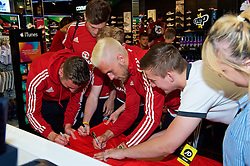 CARDIFF, WALES - Thursday, June 2, 2016: Wales' Aaron Ramsey signs autographs during a visit to a JD Sports store in Llantrisant. (Pic by Ian Cook/Propaganda)